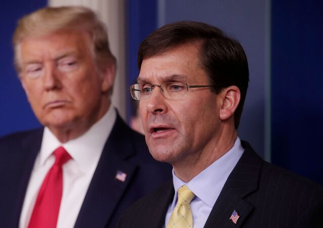 FILE PHOTO: U.S. President Donald Trump listens to Secretary of Defense Mark Esper address the daily White House coronavirus response briefing with members of the administration's coronavirus task force at the White House in Washington, U.S., March 18, 2020