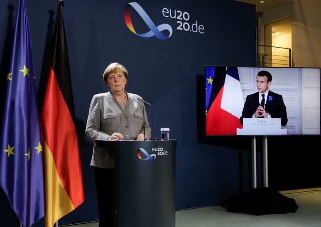 German Chancellor Angela Merkel attends a virtual news conference with French president Emmanuel Macron, on the screen, Austrian Chancellor Sebastian Kurz, Netherlands Prime Minister Mark Rutte, European Commission President Ursula von der Leyen and European Council President Charles Michel, at the chancellery in Berlin, Germany November 10, 2020