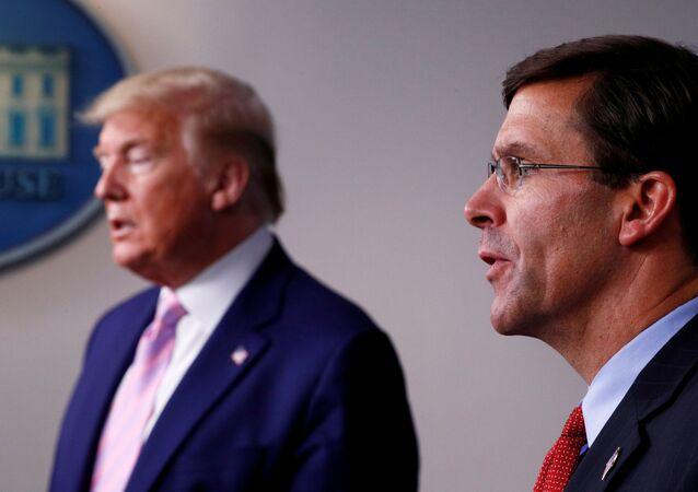 FILE PHOTO: U.S. Defense Secretary Mark?Esper speaks about U.S. military moves against Venezuela as U.S. President Donald Trump listens during the daily coronavirus response briefing at the White House in Washington, U.S., April 1, 2020. REUTERS/Tom Brenner/File Photo