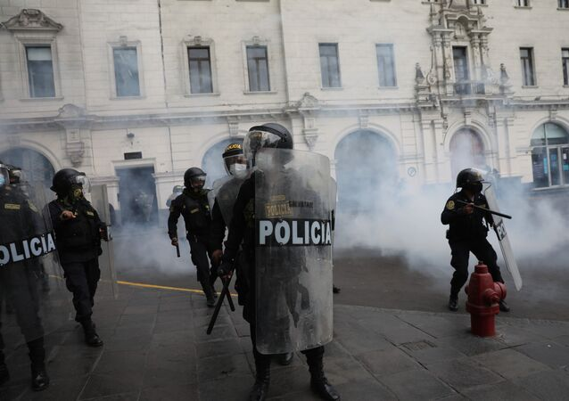 Police work to disperse supporters of former President Martín Vizcarra protesting the swearing-in of a new president, Manuel Merino, who was head of Peru's legislature, at San Martin square in Lima, Peru, Tuesday, Nov. 10, 2020.