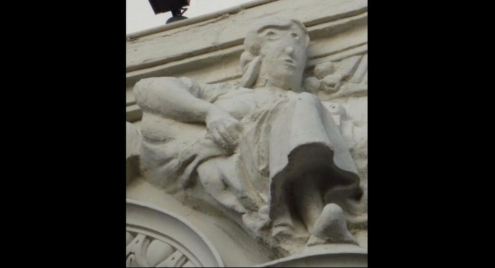 Ruined statue on top of the  Unicaja Bank headquarters in Palencia, Spain