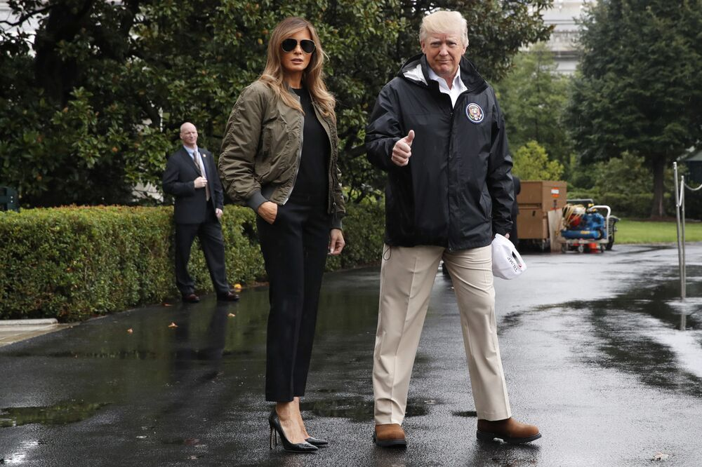 President Donald Trump, accompanied by first lady Melania Trump, gives a thumbs-up as they walk to Marine One on the South Lawn of the White House in Washington, for a short trip to Andrews Air Force Base, Maryland, then on to Texas to survey the response to Hurricane Harvey.