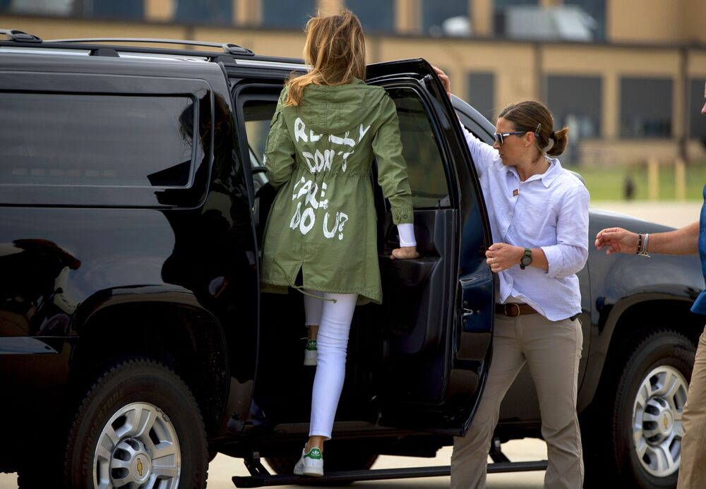 Melania Trump arrives at Andrews Air Force Base, Maryland wearing a Zara jacket that reads, I don't really care. Do U?