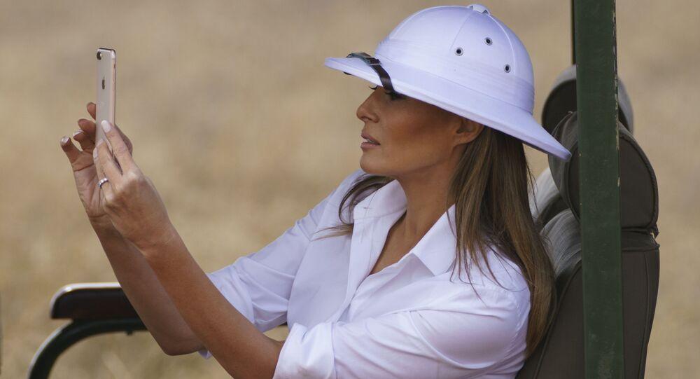 Melania Trump takes photos with her cell phone during a safari at Nairobi National Park in Nairobi, Kenya, Friday, Oct. 5, 2018.