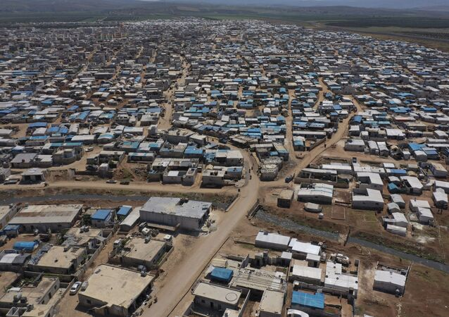 This April 19, 2020 file photo shows a large refugee camp on the Syrian side of the border with Turkey, near the town of Atma, in Idlib province, Syria