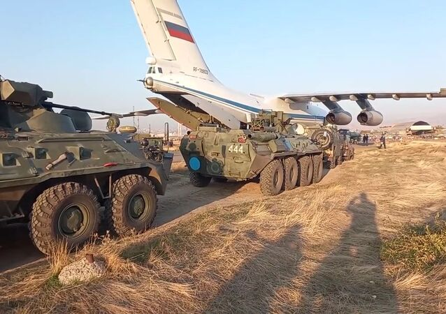 In this handout video grab released by Russian Defence Ministry, Russian peacekeepers' military equipment that is being redeployed to the Nagorno-Karabakh conflict zone, is unloaded from transport aircraft at Erebuni Airport, outside Yerevan, Armenia
