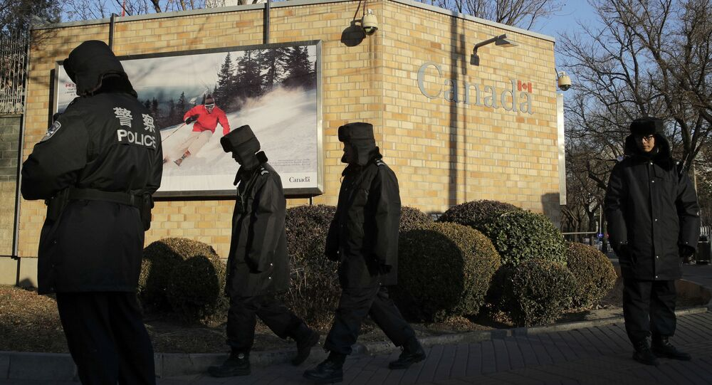 Policemen patrol outside the Canadian Embassy in Beijing, Wednesday, Dec. 12, 2018