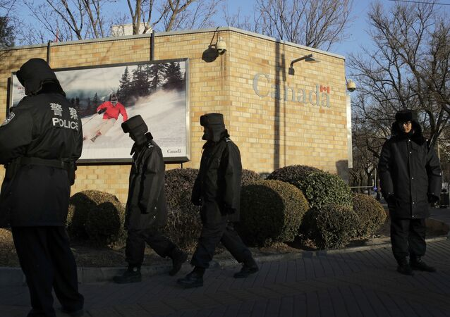 Policemen patrol outside the Canadian Embassy in Beijing, Wednesday, Dec. 12, 2018