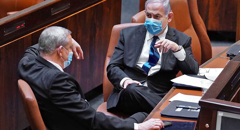 A handout picture released by the Israeli Knesset (parliament) spokesperson's office on May 17, 2020, shows Israeli Prime Minister Benjamin Netanyahu (R) and alternate PM Benny Gantz during the swearing-in ceremony of the new government in Jerusalem