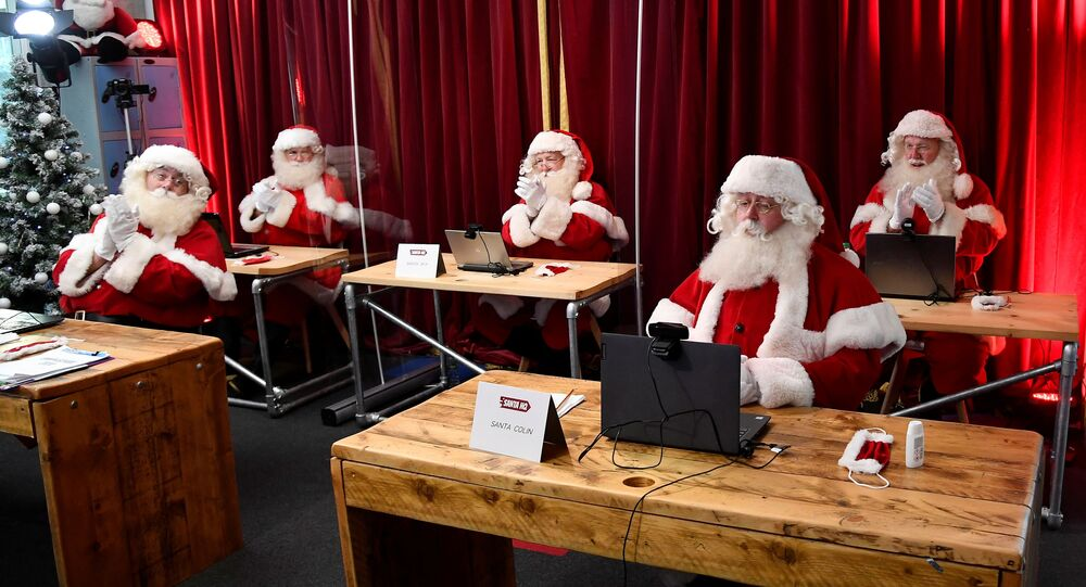 Students take part in a training session at the Ministry of Fun Santa School, as it develops an online app for children to speak with Santa during the Christmas season, as the continuation of the coronavirus disease (COVID-19) pandemic means most in-person Santa's Grotto experiences will have to be cancelled, London, Britain, November 10, 2020