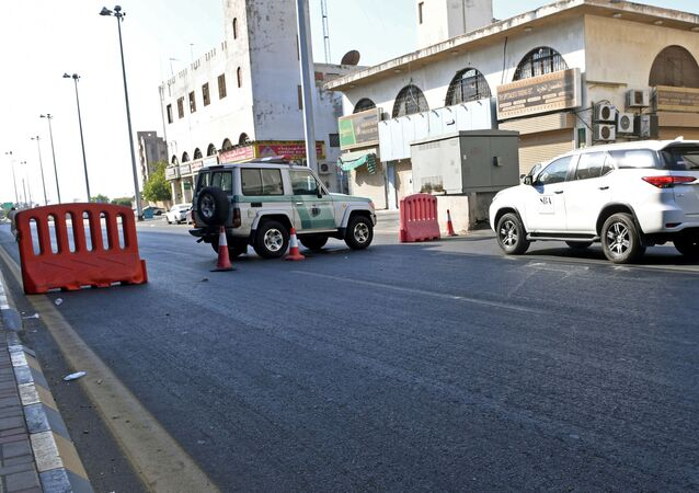 Saudi police close a street leading to a non-Muslim cemetery in the Saudi city of Jeddah where a bomb struck a World War I commemoration attended by European diplomats on November 11, 2020 leaving several people wounded amid Muslim anger over French cartoons. - The attack is the second assault in the kingdom in less than a month, as French President Emmanuel Macron has sought to assuage anger across Muslim nations over satirical cartoons of the Prophet Mohammed.