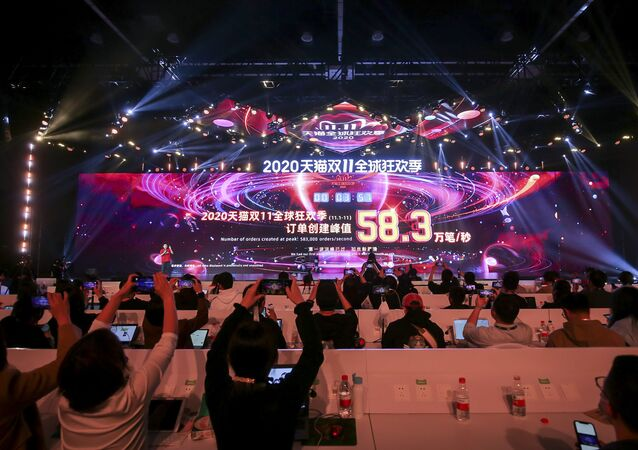 A screen shows sales information during the 2020 Tmall Global Shopping Festival on Singles' Day, also known as the Double 11 shopping festival, at a media centre in Hangzhou, in eastern China's Zhejiang province on 11 November 2020.