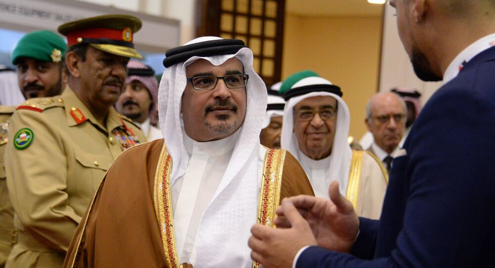 First Deputy Prime Minister and Crown Prince of the Kingdom of Bahrain Salman bin Hamad al-Khalifa (centre) at the BIDEC-2017 international defence exhibition in Bahrain.