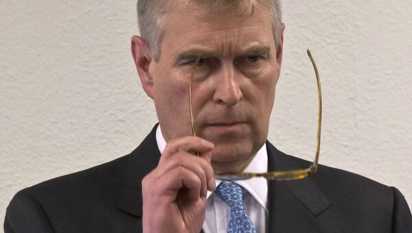 In this file photo dated Thursday, Jan. 22, 2015, Britain's Prince Andrew, puts on his glasses prior to his speech to business leaders during a reception at the sideline of the World Economic Forum in Davos. Britain's Prince Andrew said Wednesday Nov. 20, 2019 - Sputnik International