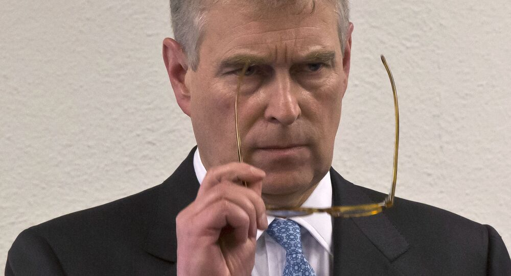 In this file photo dated Thursday, Jan. 22, 2015, Britain's Prince Andrew, puts on his glasses prior to his speech to business leaders during a reception at the sideline of the World Economic Forum in Davos. Britain's Prince Andrew said Wednesday Nov. 20, 2019