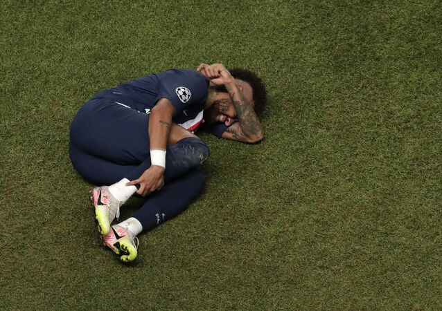 In this Sunday, 23 August 2020 file photo, PSG's Neymar lies on the ground during the Champions League final soccer match between Paris Saint-Germain and Bayern Munich at the Luz stadium in Lisbon, Portugal