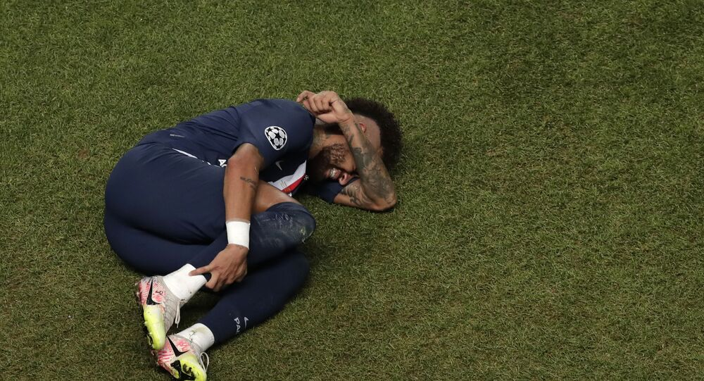 In this Sunday, Aug. 23, 2020 file photo, PSG's Neymar lies on the ground during the Champions League final soccer match between Paris Saint-Germain and Bayern Munich at the Luz stadium in Lisbon, Portugal