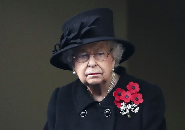 Britain's Queen Elizabeth II looks on from the balcony of the Foreign Office, during the Remembrance Sunday service at the Cenotaph, in Whitehall, London, Sunday Nov. 8, 2020