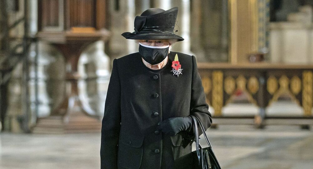 Britain's Queen Elizabeth II attends a ceremony to mark the centenary of the burial of the Unknown Warrior, in Westminster Abbey, London, Wednesday, Nov. 4, 2020
