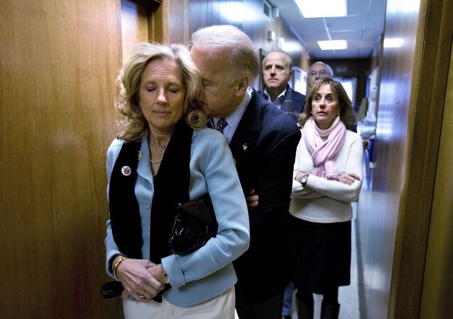 Delaware Senator and presidential candidate for the Democrats, Joe Biden, rests his head on the shoulder of his wife, Jill, as they stand in a hallway waiting for him to be introduced into a a rally at the UAW Hall in Dubuque, Iowa, on the day of the Iowa caucus Thursday, 3 January 2008.