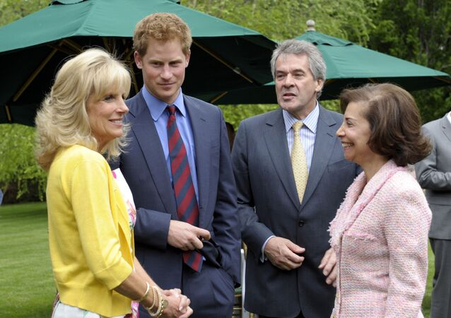 Britain's Prince Harry talks with Dr. Jill Biden, left, and British Ambassador Sir Peter Westmacott, second from right, and his wife Susie Nemazee, right, during a reception at the British Ambassador's Residence in Washington, Monday, May 7, 2012