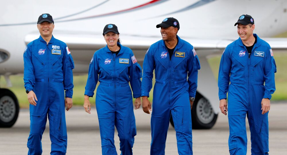NASA astronauts Shannon Walker, Victor Glover, Mike Hopkins, and JAXA (Japan Aerospace Exploration Agency) and astronaut Soichi Noguchi, who comprise Crew-1, walk at Kennedy Space Center ahead of the NASA/SpaceX launch of the first operational commercial crew mission in Cape Canaveral, Florida, 8 November 2020