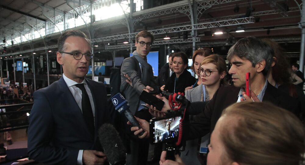 German Foreign Minister Heiko Maas answers reporters as he attends the Paris Peace Forum, Tuesday, Nov. 12, 2019 in Paris