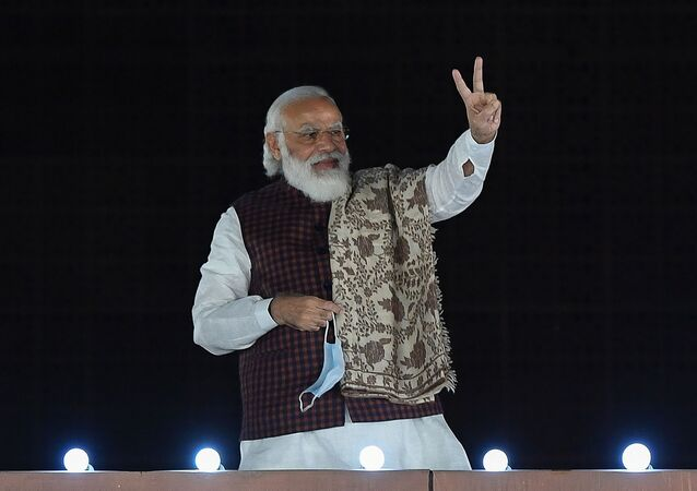 India's Prime Minister Narendra Modi gestures during the celebrations after the victory in Bihar assembly election and by-election in other states at the Bharatiya Janata Party (BJP) headquarters in New Delhi on November 11, 2020
