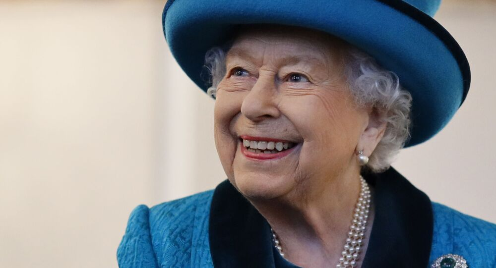Britain's Queen Elizabeth II visits the new headquarters of the Royal Philatelic society in London on 26 November 2019