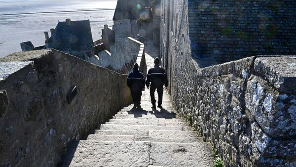 French gendarmes patrol on the defensive wall walk in Le Mont-Saint-Michel, Normandy, northwestern France, on November 12, 2020, as France is on a second lockdown aimed at containing the spread of Covid-19 pandemic caused by the novel coronavirus. - Sputnik International