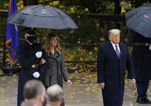 President Donald Trump and first lady Melania Trump observe Veterans' Day at Arlington National Cemetery in Arlington, Virginia, Wednesday, 11 November 2020.
