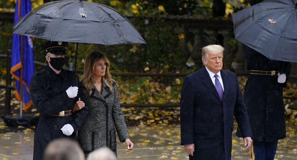 President Donald Trump and first lady Melania Trump observe Veterans' Day at Arlington National Cemetery in Arlington, Virginia, Wednesday, 11 November 2020.