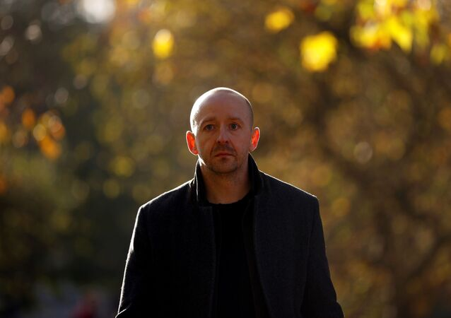 Lee Cain, who has resigned as Downing Street Director of Communications, walks through St James's Park in London, England, 12 November 2020.