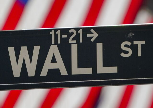 In this Wednesday, Oct. 14, 2020 file photo, the American Flag hangs outside the New York Stock Exchange in New York