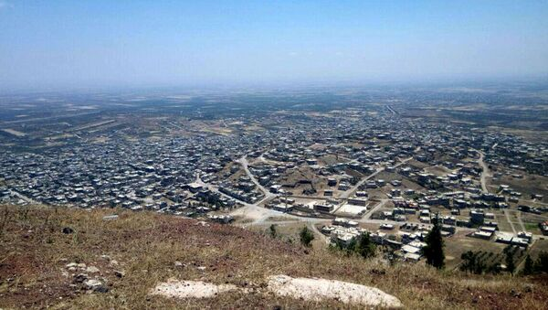 This photo released Tuesday, July 17, 2018, by the Syrian official news agency SANA, shows a general view of Tell al-Haara, from the highest hill in the southwestern Daraa province, Syria. - Sputnik International