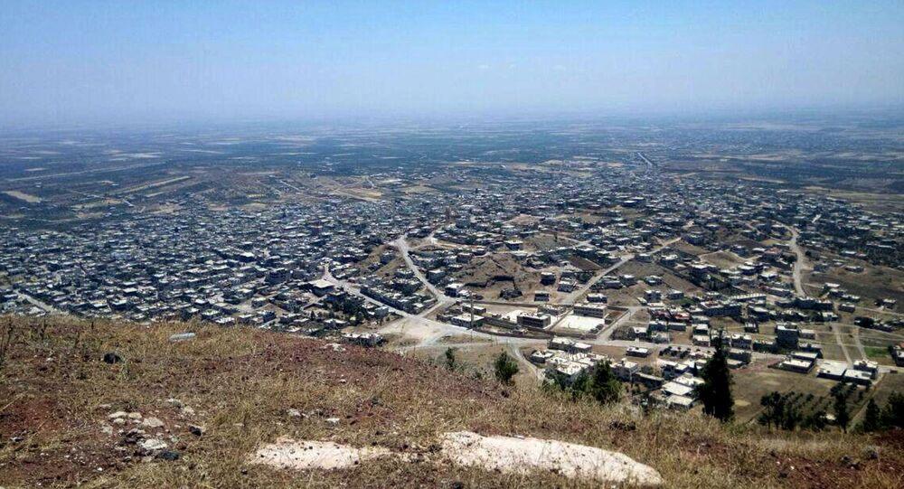 This photo released Tuesday, July 17, 2018, by the Syrian official news agency SANA, shows a general view of Tell al-Haara, from the highest hill in the southwestern Daraa province, Syria.
