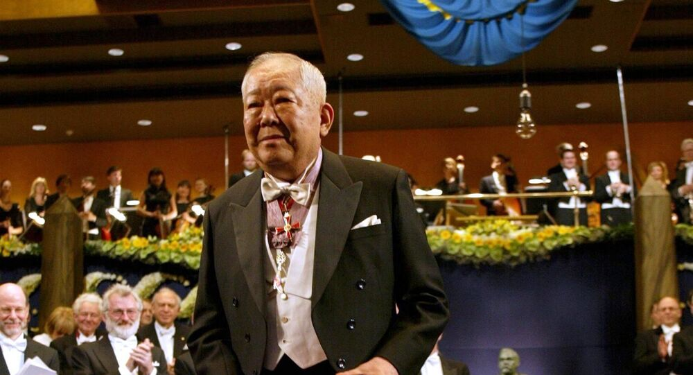 Masatoshi Koshiba of Japan bows after receiving the Nobel Prize in Physics from King Carl Gustaf of Sweden (not pictured) during a ceremony at the Concert Hall in Stockholm, 10 December 2002