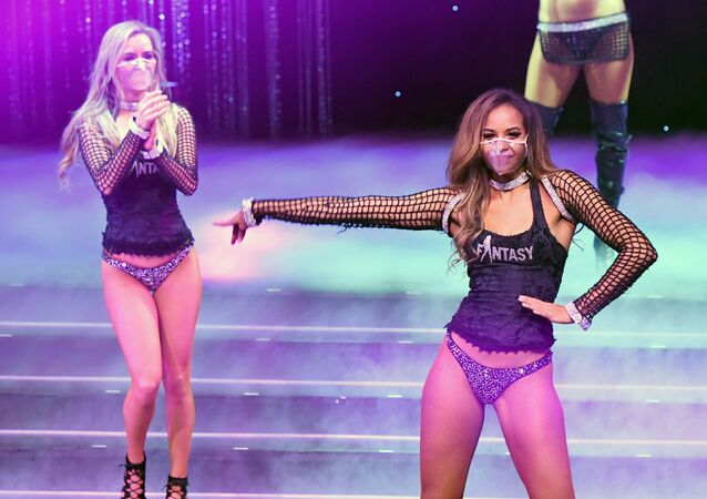 Dancers Mariah Rivera (L) and Ashton Bray take a curtain call during the Fantasy show at Luxor Hotel & Casino on 9 November 2020 in Las Vegas, Nevada.