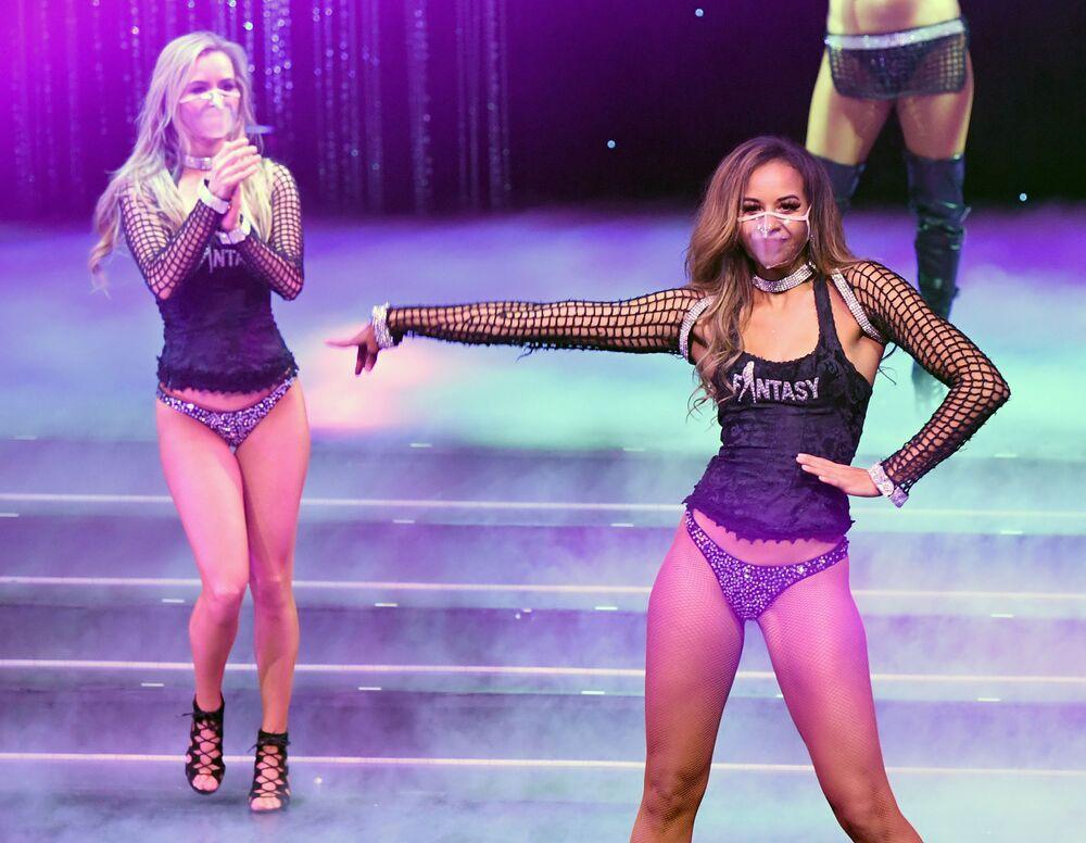 Dancers Mariah Rivera (L) and Ashton Bray take a curtain call during the Fantasy show at Luxor Hotel & Casino on 9 November 2020 in Las Vegas, Nevada.