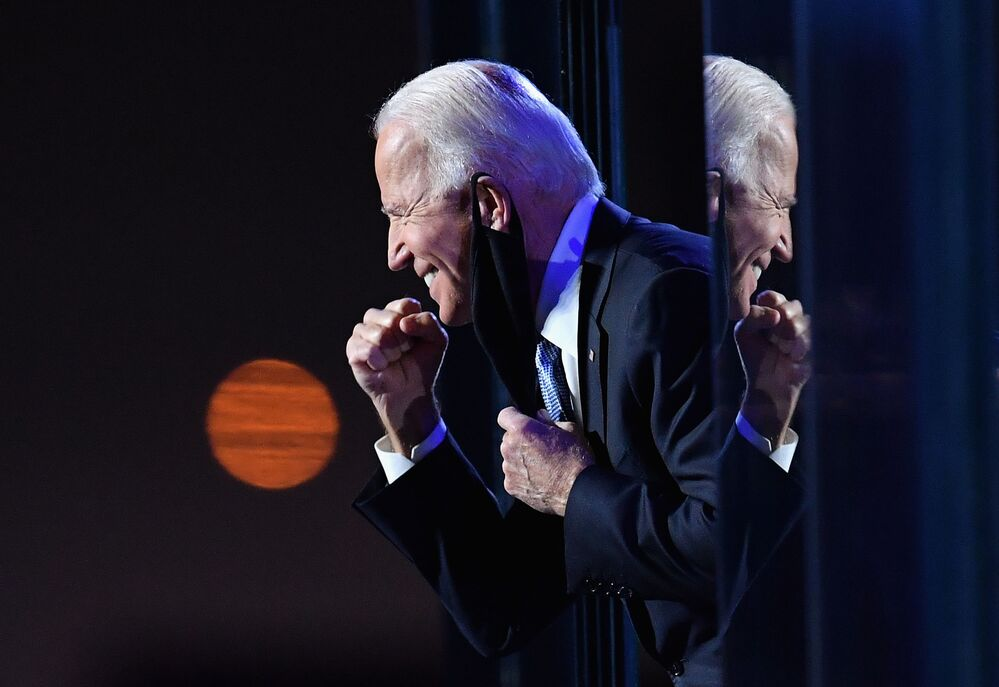 The US presidential candidate for the Democrats, Joe Biden, gestures to the crowd after he delivered remarks in Wilmington, Delaware, on 7 November 2020.