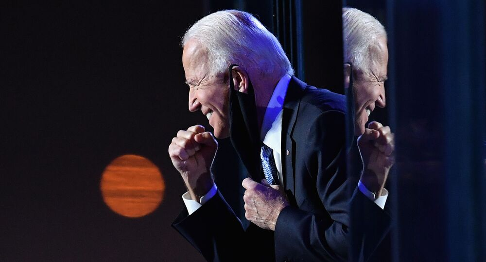 The US Democratic presidential candidate Joe Biden gestures to the crowd after he delivered remarks in Wilmington, Delaware, on November 7, 2020.
