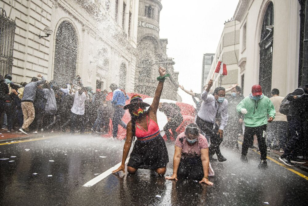 Supporters of ousted Peruvian President Martin Vizcarra, who was removed in an impeachment vote late Monday, demonstrate against the new government in Lima on November 10, 2020.