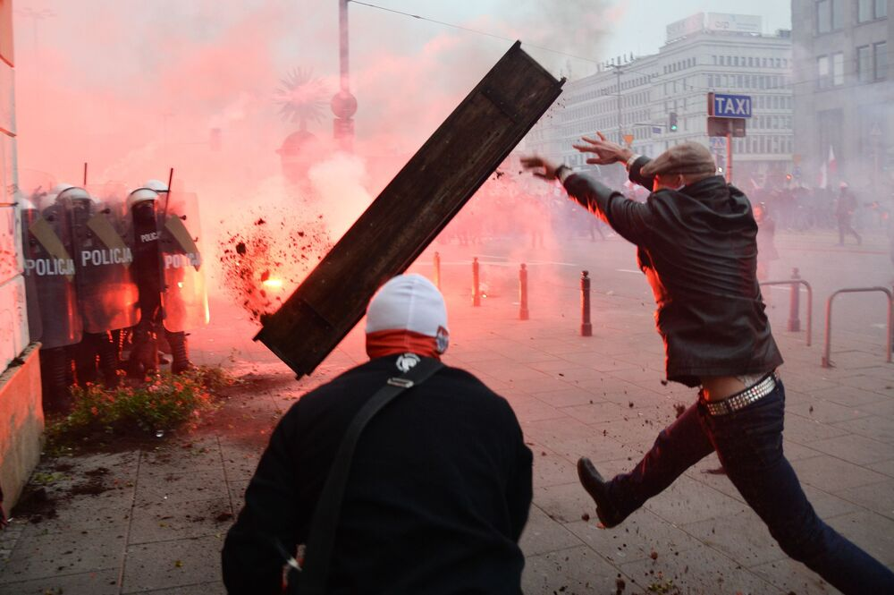Participants of a nationalist march clash with police in Warsaw on Poland's Independence Day, 11 November 2020.