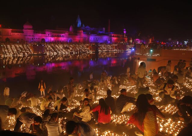 Devotees light earthen lamps on the banks of the River Sarayu as part of Diwali celebrations in Ayodhya, India, India, Tuesday, Nov. 6, 2018