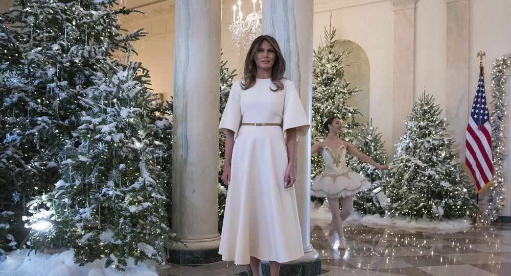 First lady Melania Trump pauses as a ballerina performs a piece from The Nutcracker behind her among the 2017 holiday decorations in the Grand Foyer of the White House in Washington, 27 November 2017