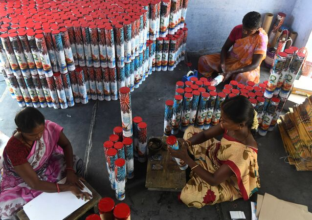 In this photograph, taken on 14 October 2019, workers produce firecrackers at a manufacturing unit involved in the production of different varieties of firecrackers ahead of the Hindu festival of Diwali, in Sivakasi