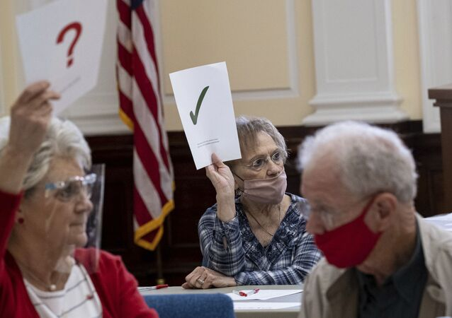 Officials sort ballots during an audit at the Floyd County administration building in Rome, Georgia, on Friday morning, 13 November 2020. Election officials in Georgia's 159 counties are undertaking a hand tally of the presidential vote that stems from an audit required by state law.