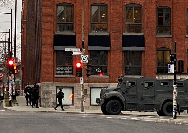 Police maintain a security cordon after media reports of a hostage incident at the offices of gaming software developer Ubisoft in Montreal, Quebec, Canada November 13, 2020.