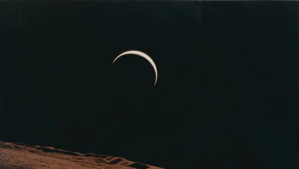Crescent Earth rising beyond the Moon's barren horizon, 1971.  - Sputnik International