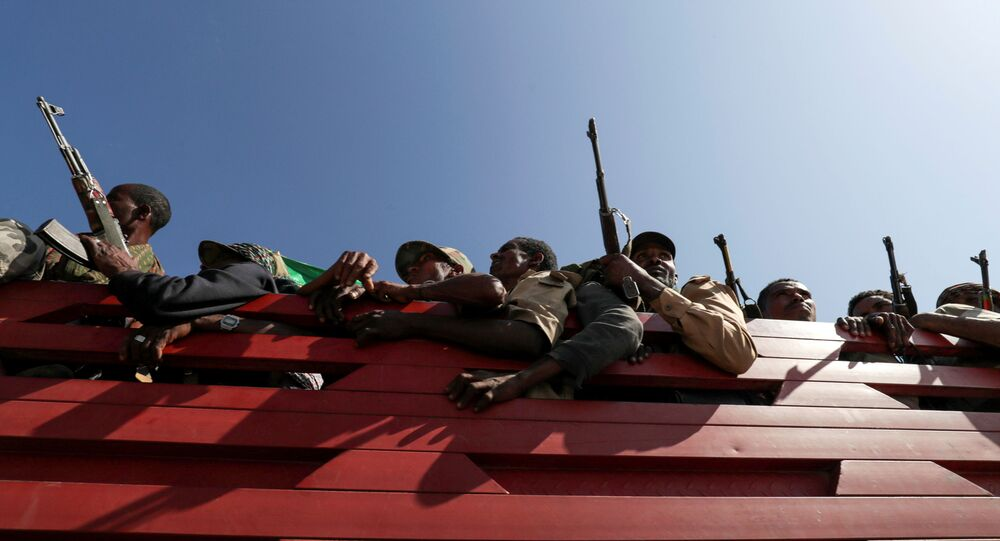 FILE PHOTO: Members of Amhara region militias ride on their truck as they head to the mission to face the Tigray People's Liberation Front (TPLF), in Sanja, Amhara region near a border with Tigray, Ethiopia November 9, 2020.